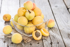 Some Apricots. Some fresh and sweet Apricots on vintage wooden background Royalty Free Stock Photos
