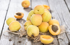 Some Apricots. Some fresh and sweet Apricots on vintage wooden background stock photos