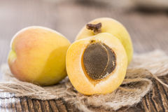 Some Apricots. Some fresh and sweet Apricots on vintage wooden background royalty free stock images