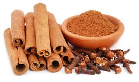 Some aromatic cinnamon with cloves and ground spice. Over white background Royalty Free Stock Photography