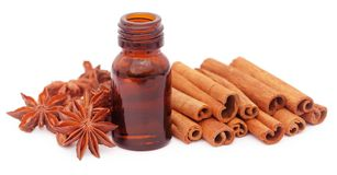 Some aromatic cinnamon with star anise and essential oil. In a bottle Royalty Free Stock Photo