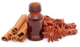 Some aromatic cinnamon with star anise and essential oil. In a bottle Stock Images