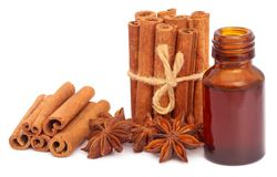 Some aromatic cinnamon with star anise and essential oil. In a bottle Stock Photos