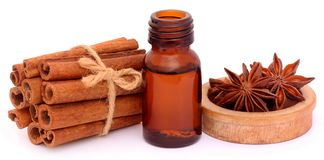 Some aromatic cinnamon with star anise and essential oil. In a bottle over white Stock Photography
