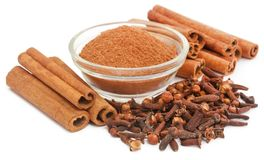 Some aromatic cinnamon with star anise. And ground spice in a bowl Stock Photo