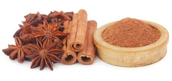 Some aromatic cinnamon with star anise. And ground spice in a bowl Royalty Free Stock Images