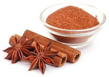 Some aromatic cinnamon with star anise and ground spice. In a bowl stock images