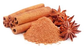 Some aromatic cinnamon with star anise and ground spice. Over white background Royalty Free Stock Photos
