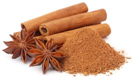 Some aromatic cinnamon with star anise and ground spice. Over white background Stock Photography
