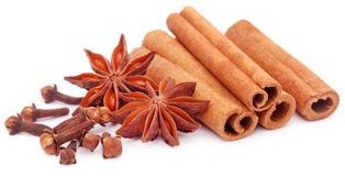 Some aromatic cinnamon with star anise. Over white background Stock Photos