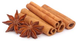 Some aromatic cinnamon with star anise. Over white background Royalty Free Stock Photography