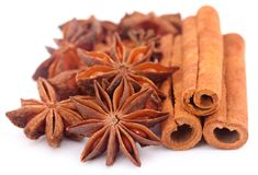 Some aromatic cinnamon with star anise. Over white background stock photography