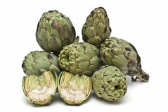 Some  artichokes. Some artichokes isolated on a white background Stock Images