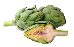 Some artichokes. Cutting half and whole artichoke isolated on white background Stock Photos