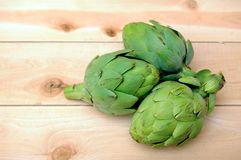 Some of artichokes. Three of artichokes with copy space for design Stock Photos