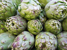 Some artichokes in a market. Stock Photos