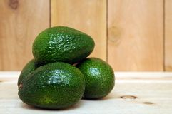 Some avocado fruits. With copy space stock photos