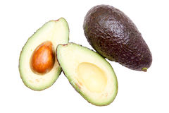 Some avocado top. Some avocado seen from above on white background royalty free stock photography