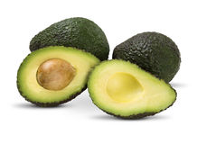 Some avocados over a white background. Fresh Fruits Royalty Free Stock Images