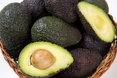 Some avocados over a white background. Fresh Fruits Stock Images