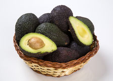 Some avocados over a white background. Royalty Free Stock Photography