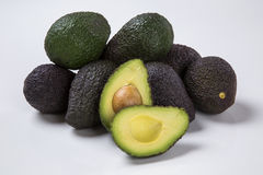 Some avocados over a white background. stock image