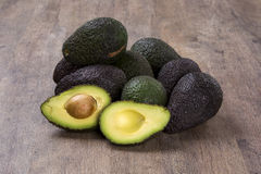 Some avocados over a wooden surface. Fresh fruits Stock Images