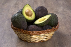 Some avocados over a wooden surface. Stock Image