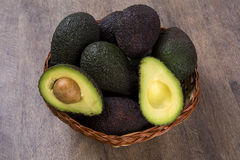 Some avocados over a wooden surface. Fresh fruits Royalty Free Stock Photography