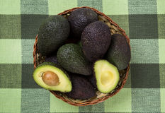 Some avocados over a wooden surface. Fresh fruits Stock Image