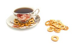 Some bagels and cup of tea. Many bagels and cup of tea on white closeup Stock Photo