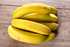 Bananas on the wooden table. Some bananas on the wooden table royalty free stock image