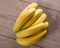 Bananas on the wooden table. Some bananas on the wooden table stock photography