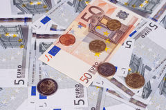 Some banknotes on five and fifty euros and coins Stock Images