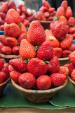 Red, delicious strawberries. Some basket of strawberries at the market Stock Images