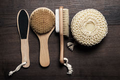 Some bath accessories on brown wooden background Stock Image