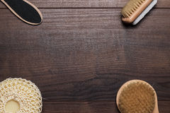Some bath accessories over wooden background Stock Photos