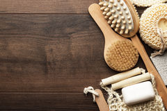 Some bath accessories on brown wooden background royalty free stock photo
