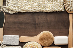 Some bath accessories on brown wooden background Royalty Free Stock Photography