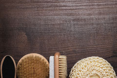 Some bath accessories on wooden background Stock Images