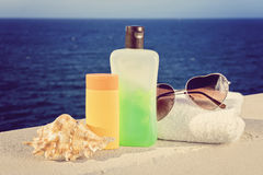 Some beach accessories. On the blue sea background Stock Images