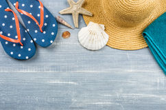 Some beach accessories. On a wooden background Royalty Free Stock Photos