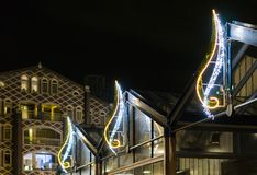 Beautiful christmas light decorations on buildings to decorate the city streets at night. Some beautiful christmas light decorations on buildings to decorate the royalty free stock images