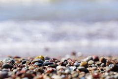 Beautiful colorful rocks on beach. Some beautiful colorful rocks on a beach. Bokeh is very nice. Color is vivid. Rocks are wet and in various shapes. Concept royalty free stock image