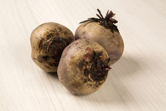Some beets in a basket over a white background Stock Images