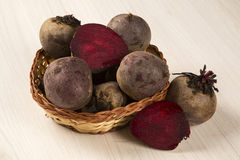 Some beets in a basket over a white background. Fresh vegetable Royalty Free Stock Photos