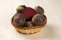 Some beets in a basket over a white background. Fresh vegetable Royalty Free Stock Image