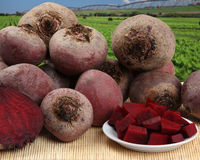 Some beets in a basket over a wooden surface. Royalty Free Stock Photos