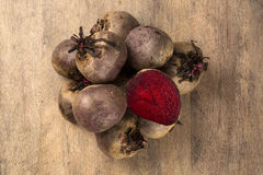 Some beets in a basket over a wooden surface Stock Photography
