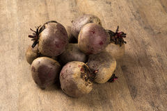 Some beets in a basket over a wooden surface Stock Photo